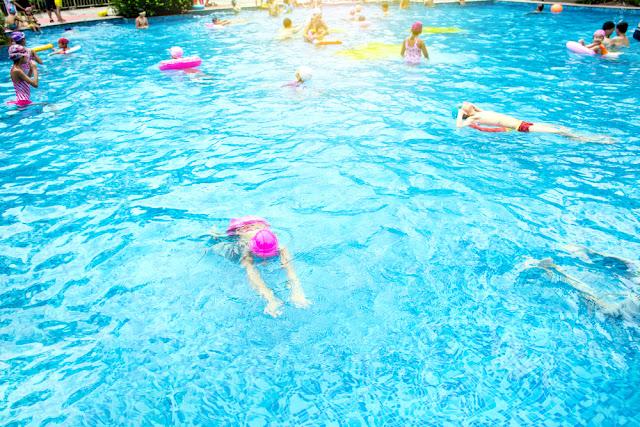 People swimming at Borngarnes Swimming Pool