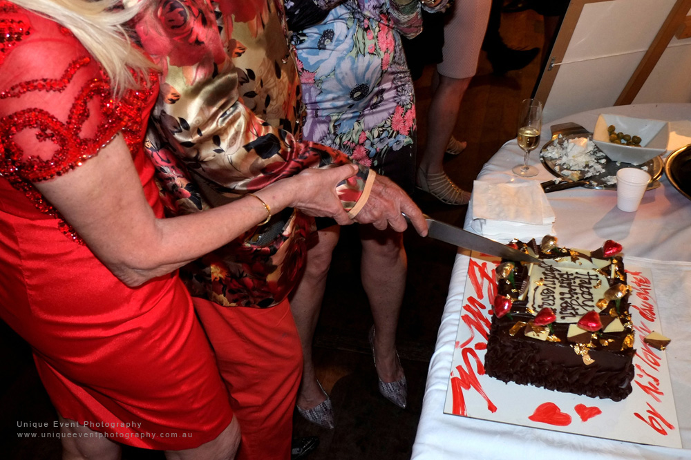 Christa and Charles cut the special anniversary cake at The Billich Gallery 30th Anniversary 'Erotica' Party - Photographed by Kent Johnson for Unique Event Photography.