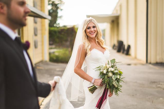 bride and groom- bride looks at camera