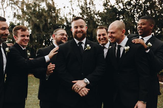 Groomsmen congratulating the Groom