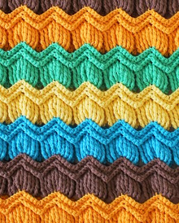 http://www.ravelry.com/patterns/library/vintage-fan-ripple-stitch-pattern