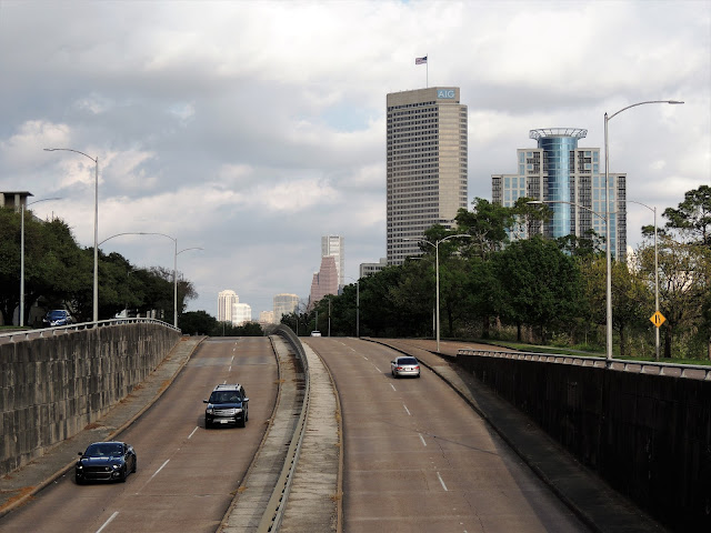 Memorial Drive underpass at Shepherd - AIG Tower and The Royalton and Downtown Skyline in the distance