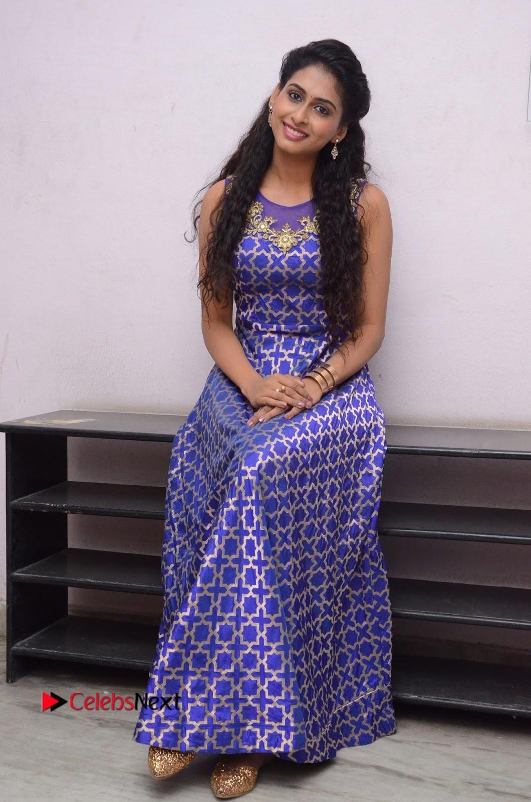 Nithya Naresh Stills in Long Dress at Nandini Nursing Home Platinum Disc Function