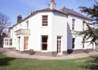 Photograph of The rear of Hawkshead House in the 1980s Image from the former NMLHS
