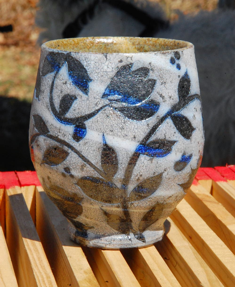 yunomi for AKAR Design Gallery with wax resist swirlware floral motifs cobalt blue