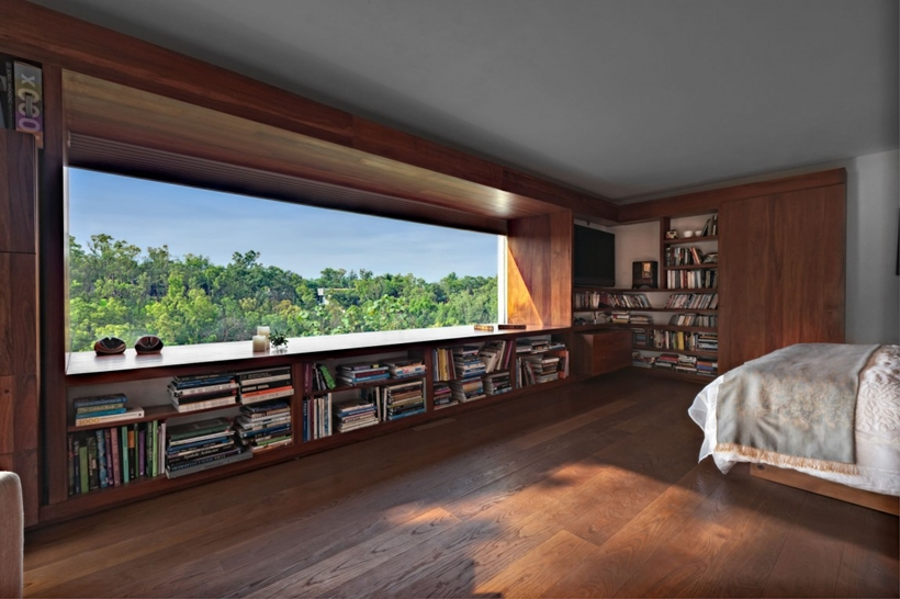 Modern bedroom with book shelf
