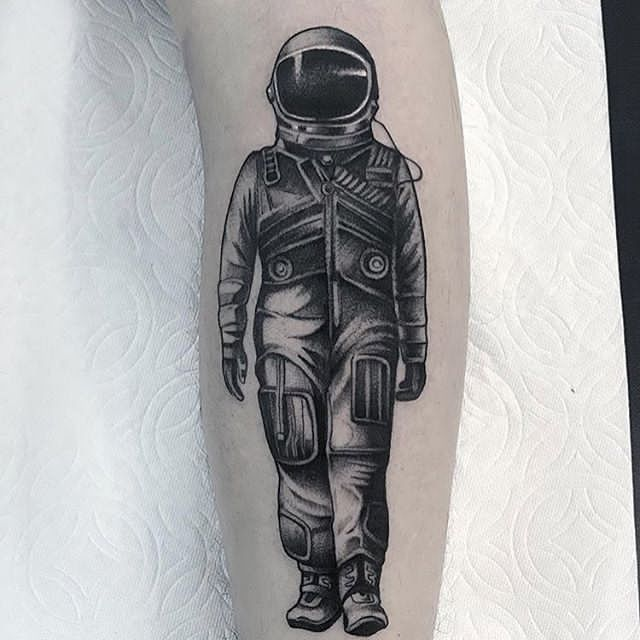 attractive astronaut tattoo