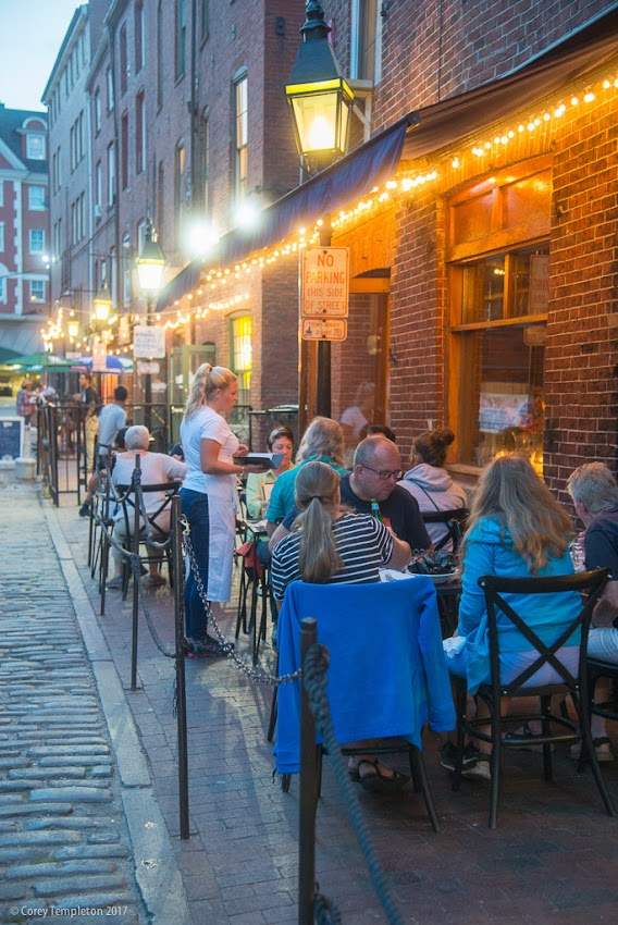 Portland, Maine USA August 2017 photo by Corey Templeton. Open air dining amongst the cobblestones of Wharf Street.
