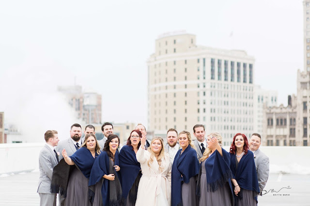 bridal party on z belt lot rooftop posing