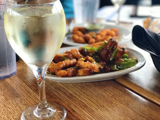 Crispy calamari and a glass of white wine at Pier Market restaurant in San Francisco