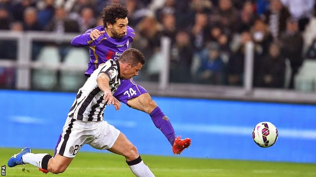 Two Mohamed Salah goals gave Fiorentina a first-leg advantage in their Coppa Italia semi-final against Juventus.