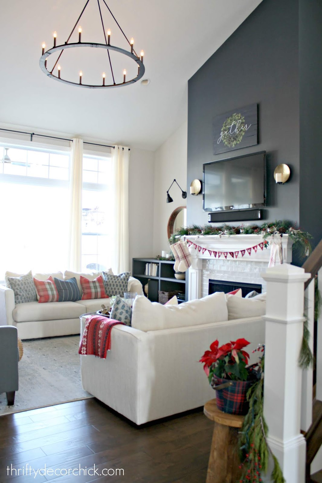 Dark blue fireplace wall in tall family room