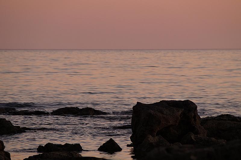 rocks in the mediterranean sea in Croatia at sunset (evening sky, blush, summer, beach)