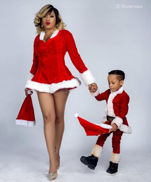 Toyin Lawani flaunts hot legs for Christmas shoot