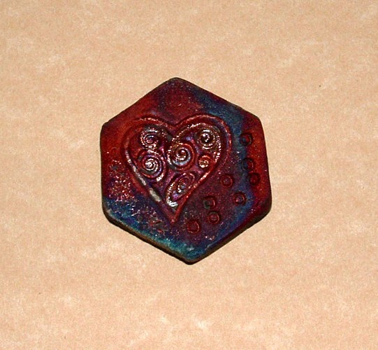 https://www.etsy.com/listing/109792053/matt-copper-heart-raku-hexagon-cabochon?ref=listing-5