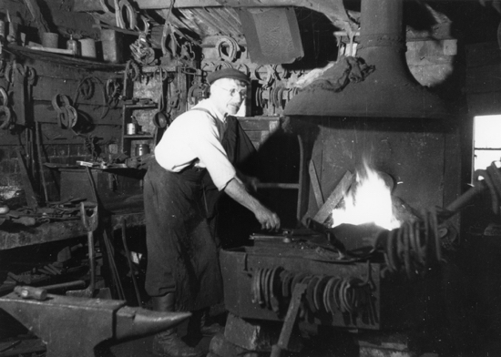 Photograph of Harry Harlow at the forge 1950s Image from B.H. Warne, part of the Images Of North Mymms collection