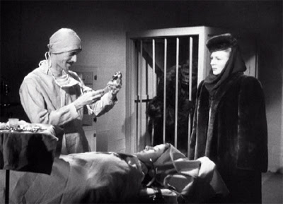 Walters (John Carradine) prepares for yet another dastardly operation