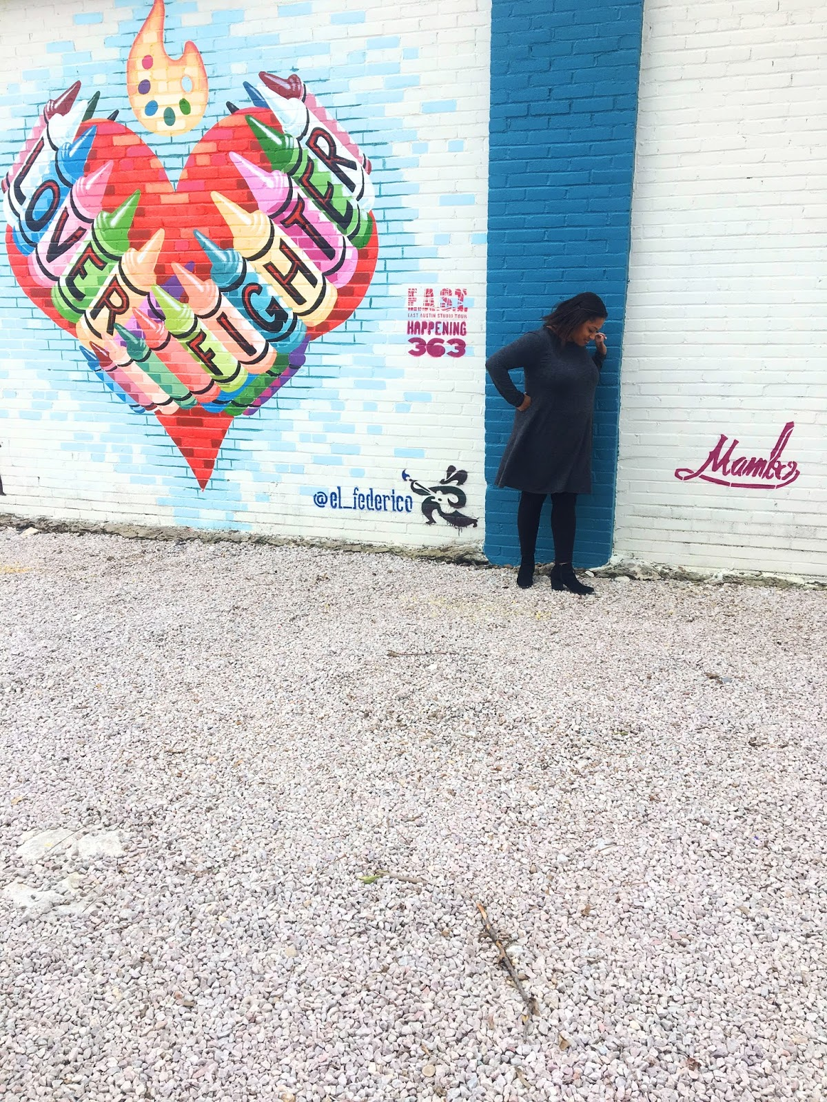"Asha Thomas ""Lover Fighter"" colorful crayon heart mural"