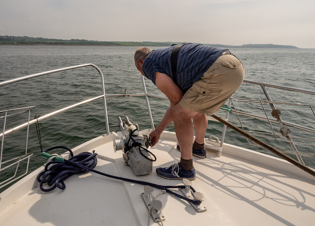 Photo of Phil bringing in the anchor