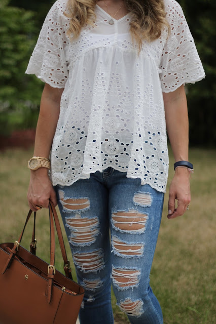 white eyelet top, distressed jeans, Tory Burch tote, pom pom lace up sandals, wood watch, casual summer look