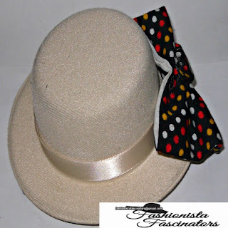 cream fascinator with a black bow tie with red, yellow and white polka dots Nairobi Kenya