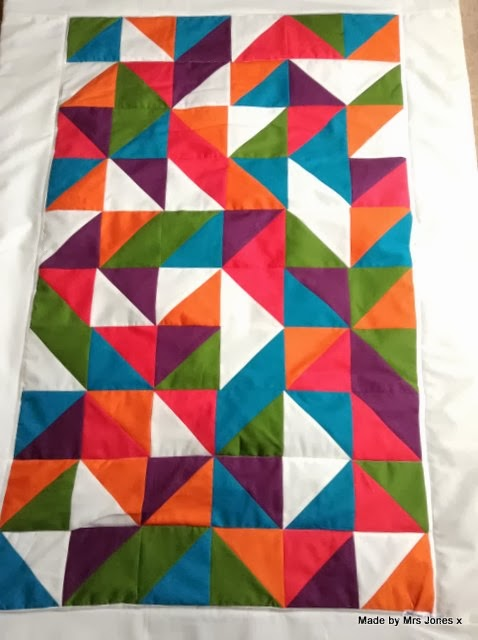 http://lifetimemrsjones.blogspot.co.uk/2014/01/half-square-triangle-quilt-triangle.html