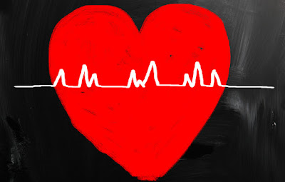 A red heart with a heartbeat graph superimposed upon it