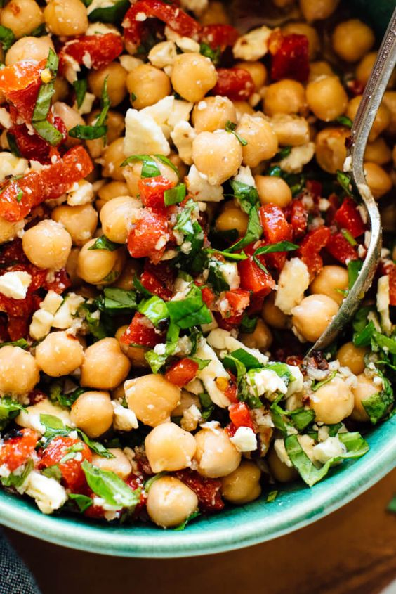 These marinated chickpeas are a little spicy, a little sweet, and totally irresistible. This recipe as great on its own as a light meal or appetizer, or served on salads or inside pitas. Recipe yields about 6 side servings.