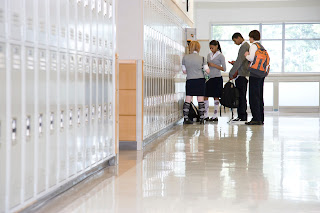 Student gather in a hallway.