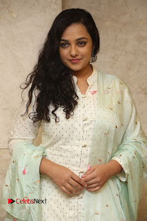 Actress Nithya Menen Latest Pictures in White Dress at 100 Days of Love Movie Audio Launch  0075.JPG