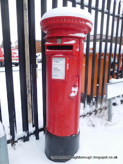 Postbox outside the sorting office Loughborough wearing a snowy hat