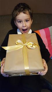 Dn Jon Jr opening a gift