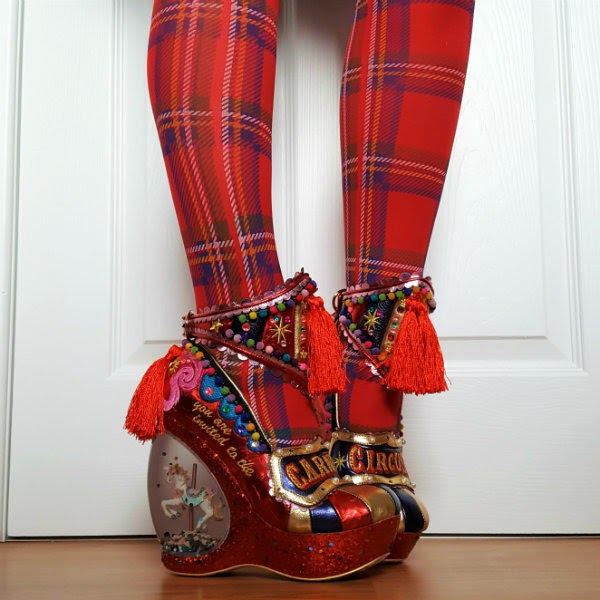 tassel ankle cuffs, red tartan tights and circus carousel shoes being worn