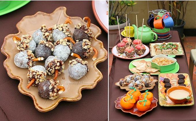 ingredients of a fall autumn party caramel apples, acorn treats, orange pumpkins