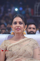 Actress Rakul Preet Singh Stills in Golden Embroidery saree at Rarandoi Veduka Chuddam Audio Launch .COM 0002.jpg