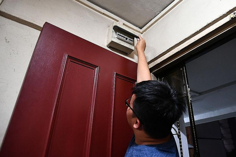 Mr Tan Qi Wei, the brother of 15-year-old Tan Yao Bin who was electrocuted while showering, showing the circuit breaker inside the family's flat yesterday.