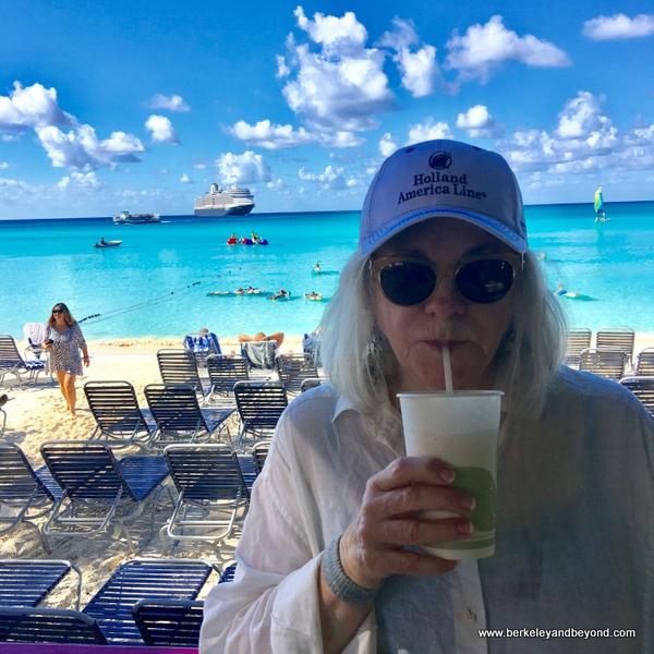 Carole Terwilliger Meyers sips a pina colada on Half Moon Cay, Bahamas