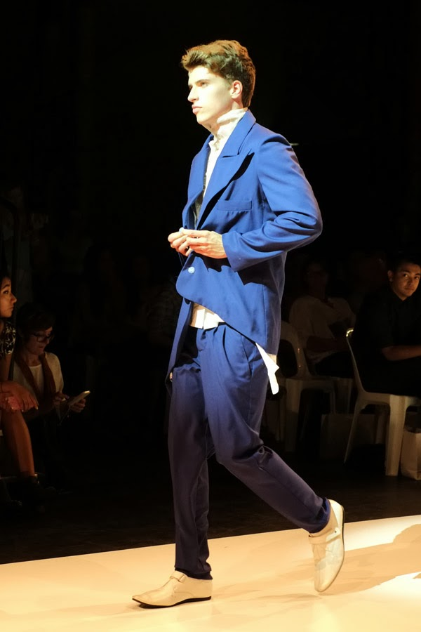 Skye Hay blue suit over white shirt - Menswear : Raffles Graduate Fashion Parade 2013  Photography by Kent Johnson.