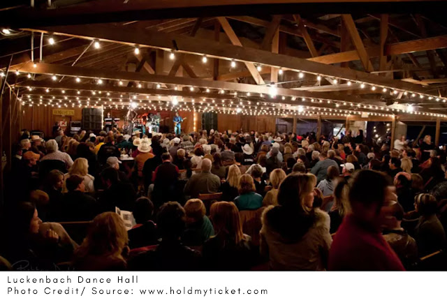 lit up rafters inside the Luckenbach Dance Hall