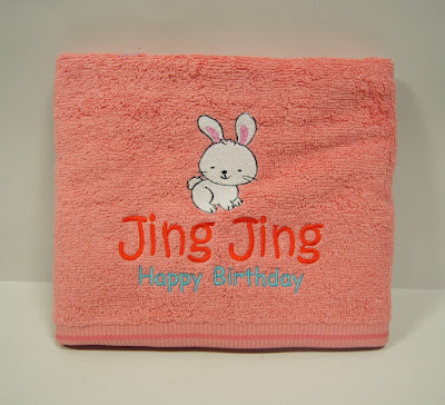 Pink towel with design and text on it