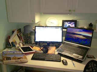desk with laptop and books