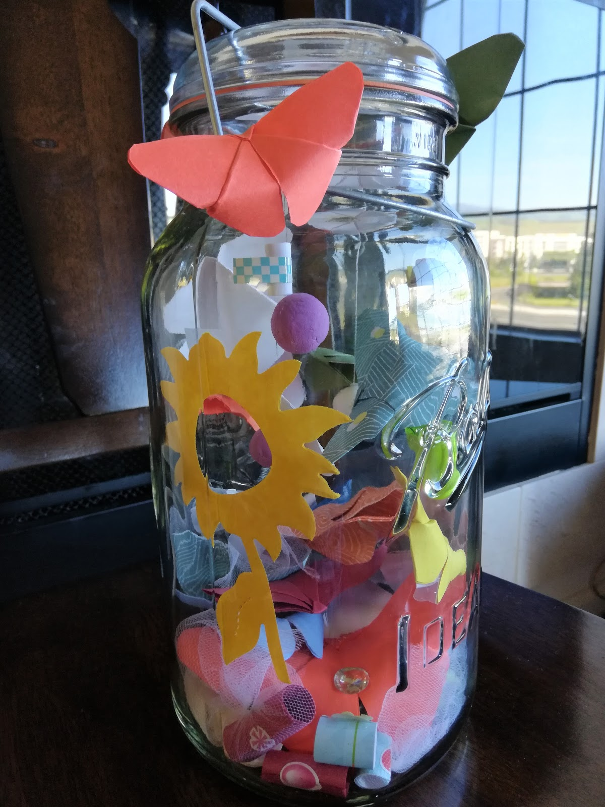 A jar filled with paper butterflies