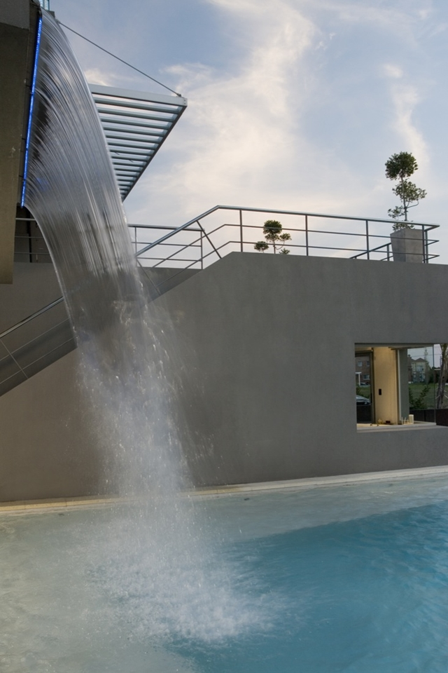 Water falling into the swimming pool