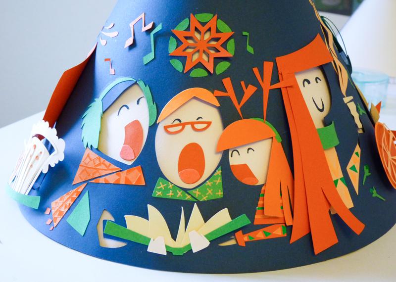 Motifs Alsaciens, chanteurs de la chorale de Noël avec écharpe, pull de noël, note de musique