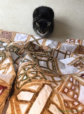 Suzi the cat with the Dear Jane quilt
