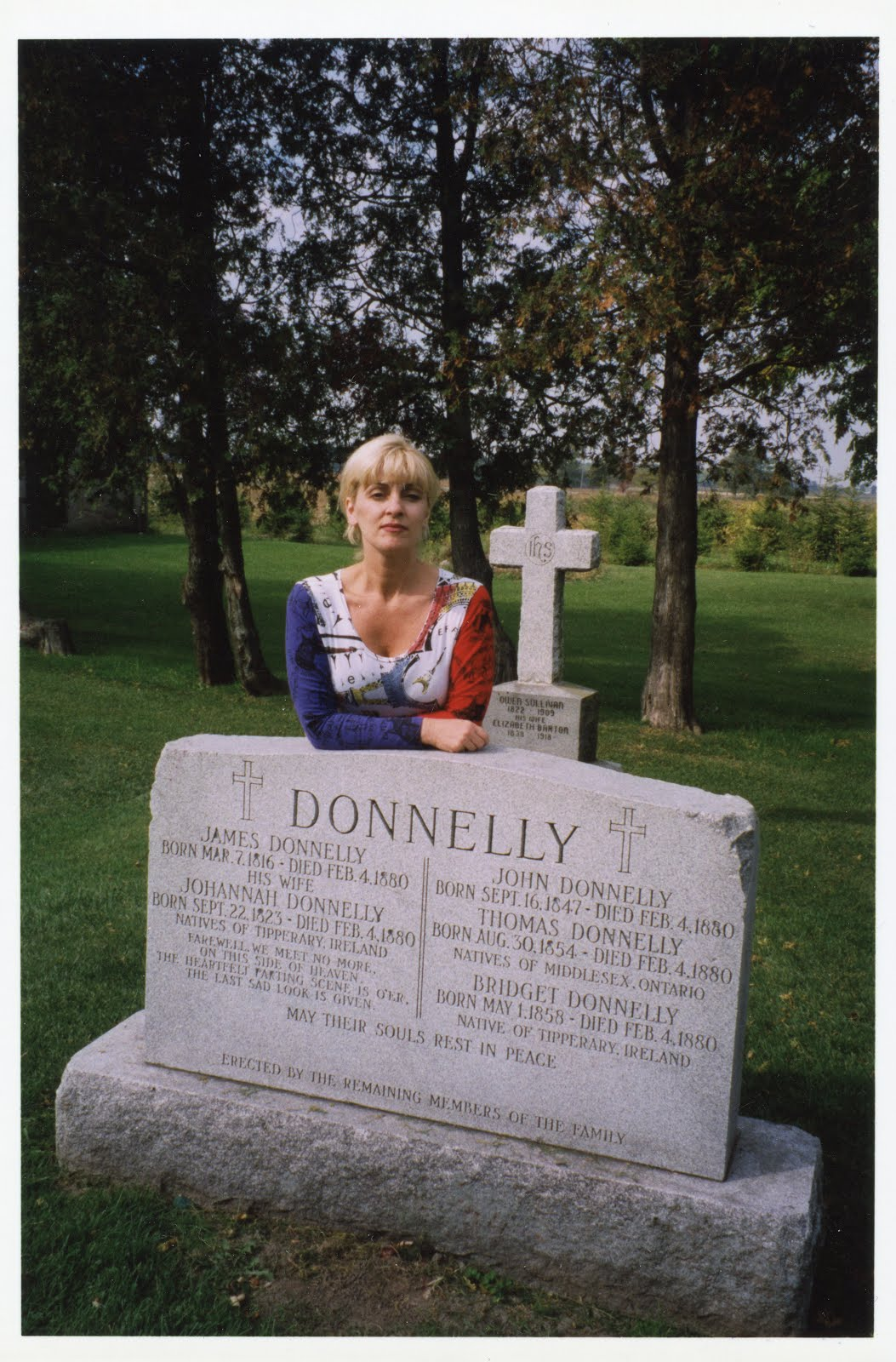 Blog author, Mary Jane Culbert at Donnelly gravesite near Lucan, Ontario (late 1990s)