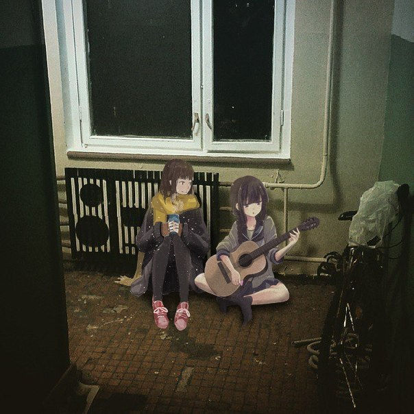 Dziewczyny z anime ogrzewają się przy grzejniku w realnym świecie