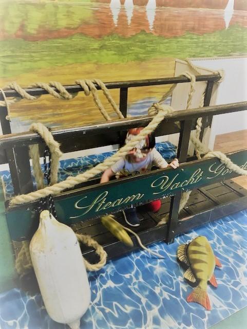 Child sitting on a mock bridge
