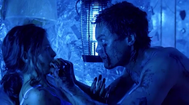 Michael Shannon tries to look inside Ashley Judd's mouth, but she ain't having it.