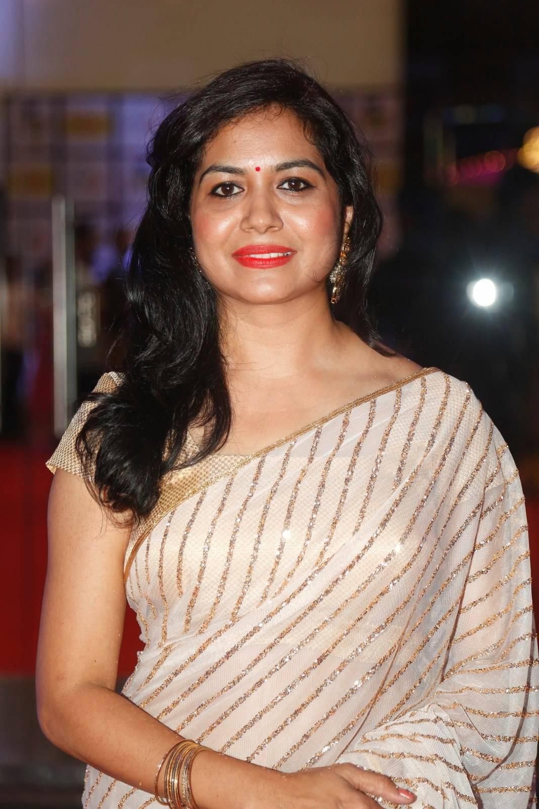 Singer Sunitha Latest Stills In White Saree